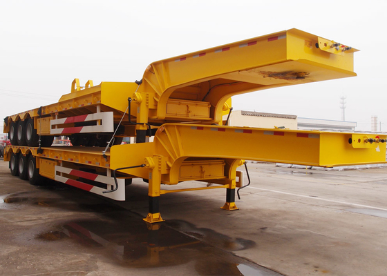 China Low bed transport semi trailer trucks with capacity 60 T semi low boy trailer supplier