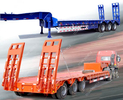 China Heavy duty Low Bed Trailer 3 axle 60 ton to 100 tons anti rust chassis surface factory