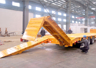 China Customized dimensions tri - axle 60 tons low bed trailer With hydraulic ramps factory
