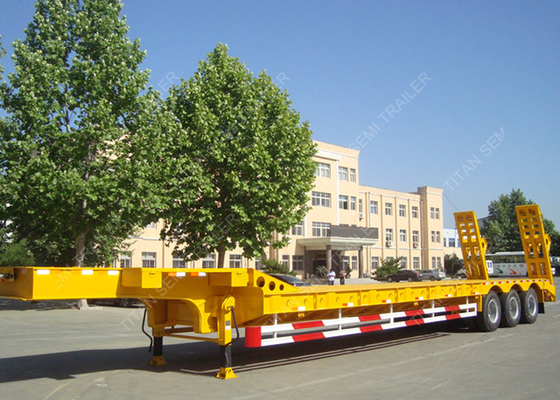 China Customized tri axle 80 ton heavy low bed semi trailer for Algeria factory